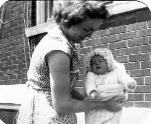 Lyla holding baby Carolyn